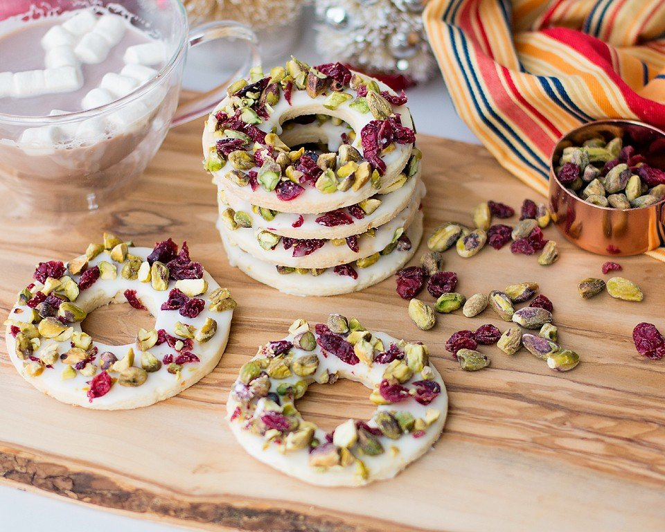 Food blogger, Bella Bucchiotti of xoxoBella, shares a recipe for cranberry lemon pistachio cookies. You will love these Christmas wreath cookies!