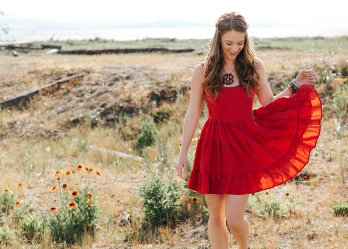 Lifestyle blogger, Bella Bucchiotti of xoxoBella shares a ruffle dress in photos taken at the Iona Beach Regional Park in British Columbia.