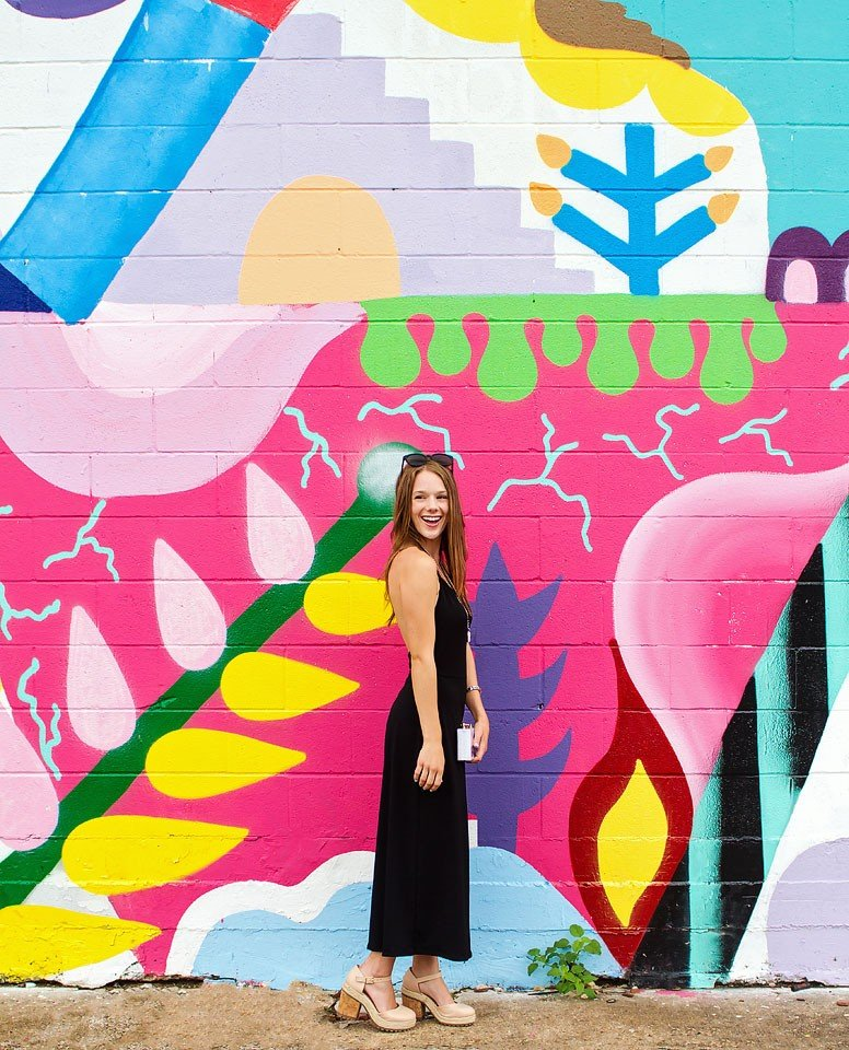 Blogger Bella Bucchiotti of xoxoBella is wearing an Urban Outfitters open back culotte jumpsuit in Houston, Texas.