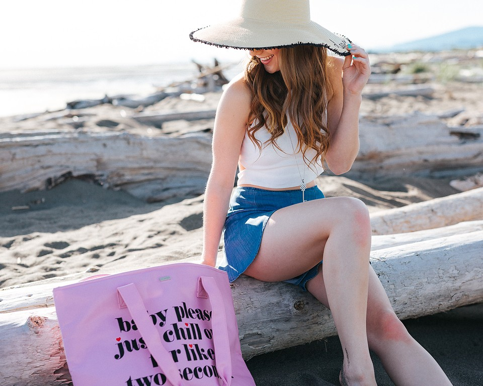 Fashion blogger, Bella Bucchiotti of xoxoBella shares some flouncy shorts and a white crop top at the beach.
