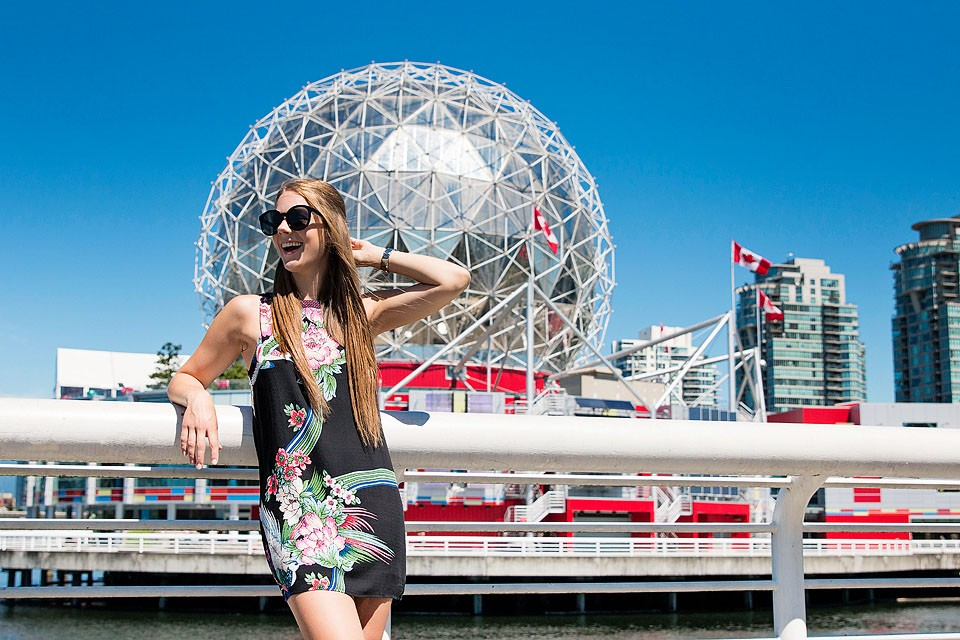 Blogger Bella Bucchiotti of xoxoBella is wearing an Urban Outfitters open back dress and Adidas shoes in Vancouver, British Columbia.