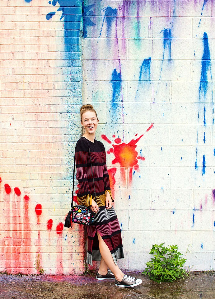 Blogger Bella Bucchiotti of xoxoBella is wearing an H&M Sweater dress at the Zipper Colorful mural in Houston.
