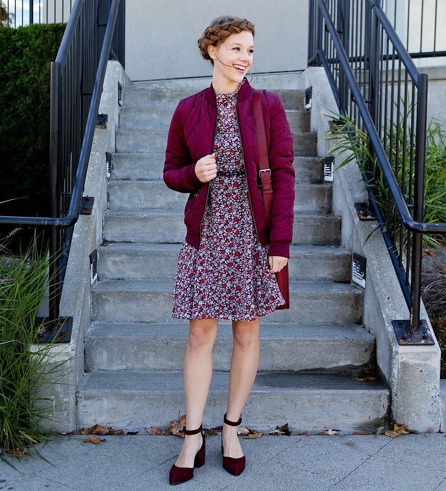 Blogger Bella Bucchiotti of xoxoBella is wearing a burgundy ditsy floral dress, bomber jacket and chunky heels from Marks & Spencer. #MarksandSpencerStyle