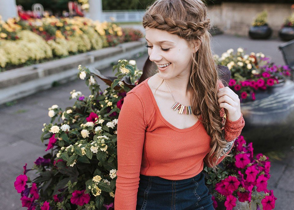 Blogger Bella Bucchiotti of xoxoBella is wearing jewelry from Uncommon Goods.