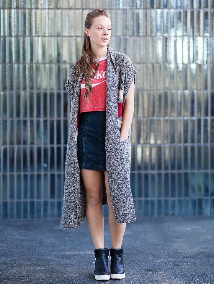 Blogger Bella Bucchiotti of xoxoBella is wearing a Roots long sweater vest, a Free People skirt and a Forever 21 Coke t-shirt.