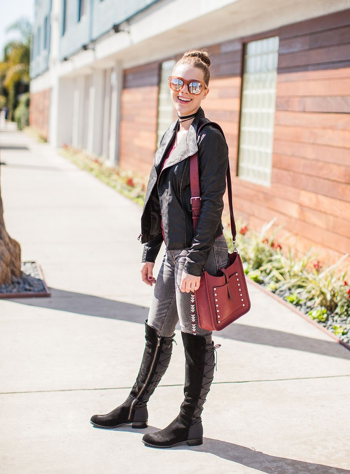 Blogger Bella Bucchiotti of xoxoBella is Wilson's Leather jacket, Michael Kors boots, Driftwood embroidered jeans and a Rebecca Minkoff bag in Venice Beach.