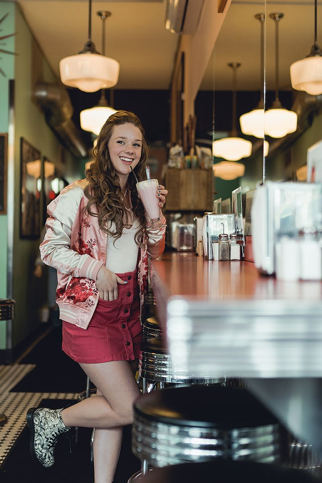 Blogger Bella Bucchiotti of xoxoBella.com shares a Forever 21 skirt and bomber with photos taken at Lucy's Eastside Diner in Vancouver.