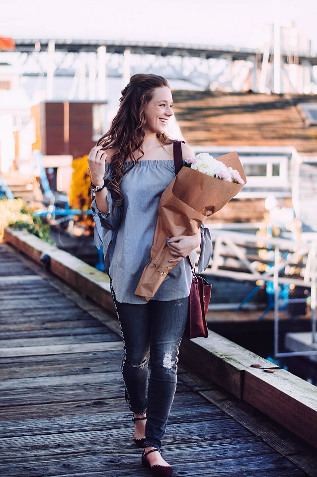 Blogger Bella Bucchiotti of xoxoBella is sharing a favourite Emma & Roe bracelet from Michael Hill. She is wearing Driftwood jeans, a Shein top, a Rebecca Minkoff bag and Halogen flats at Granville Island, BC.