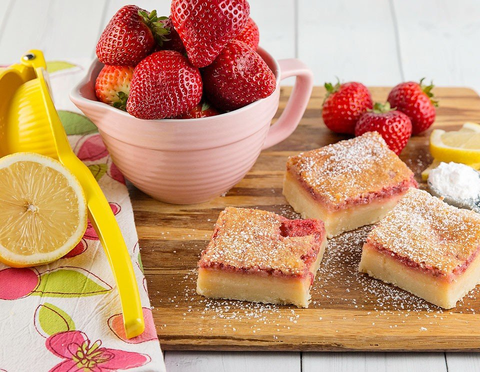 Food blogger Bella Bucchiotti of xoxoBella shares a recipe for Strawberry Lemonade Bars. They are perfect strawberry square for Valentine's Day, Easter, Wedding Showers or Baby Showers. You will love these lemon squares.