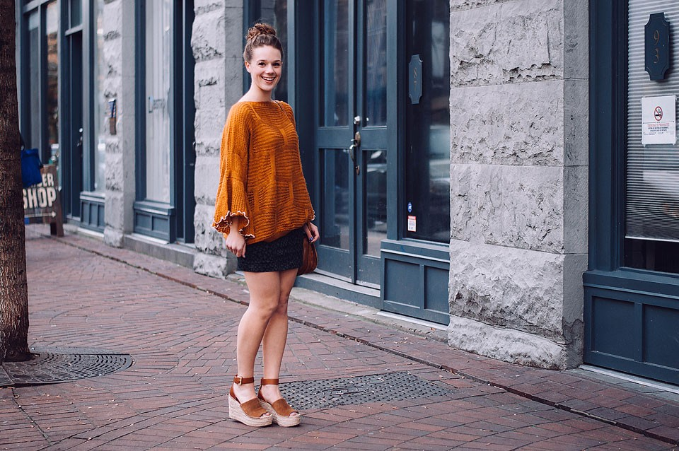 Fashion blogger, Bella Bucchiotti of xoxoBella shares a cozy orange sweater and a bun look that is perfect for running errands.