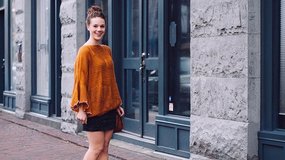 Blogger Bella Bucchiotti of xoxoBella.com shares a cozy orange sweater from Chicwish, Marc Fisher wedges, a Free People mini skirt and a Weldon bag.