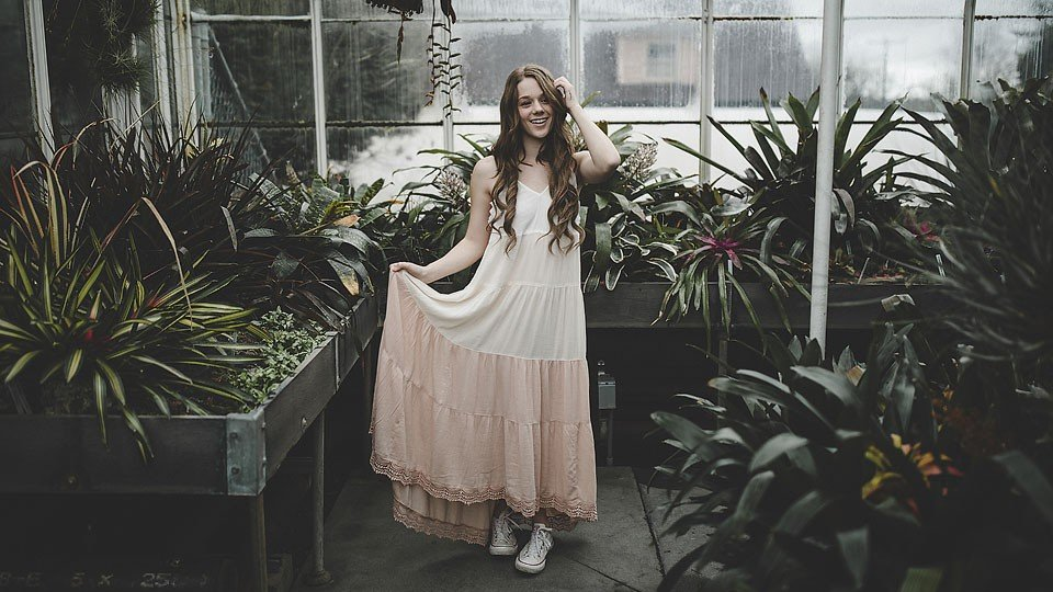 Blogger Bella Bucchiotti of xoxoBella.com shares an ombre ruffle maxi dress from Sun & Shadows via Nordstrom at the conservatory in Seattle.
