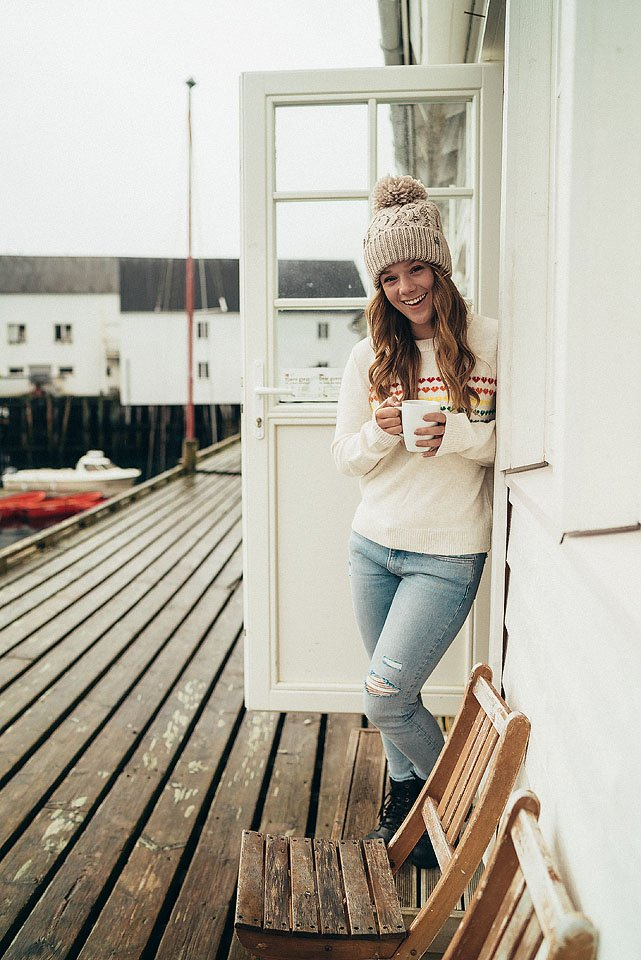 Travel blogger, Bella Bucchiotti of xoxoBella, shares about staying at the Eliassen Rorbuer at Hamnøy in the Lofoten Islands. If you travel to Norway, a stop here to experience boating and hiking in Lofoten is a bucket list must.