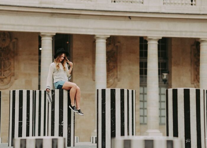 Blogger Bella Bucchiotti of xoxoBella.com shares a striped top shot at the Buren Columns at Palais-Royale in Paris.