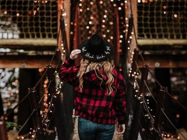 Blogger Bella Bucchiotti of xoxoBella.com shares her trip to the Capilano Suspension Bridge in Vancouver, British Columbia. She is wearing a jacket and beanie from Lulus. Photo by Allison Kuhl.