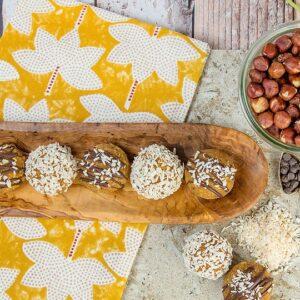Blogger Bella Bucchiotti of xoxoBella.com shares a recipe for raw vegan no bake carrot cake energy balls.