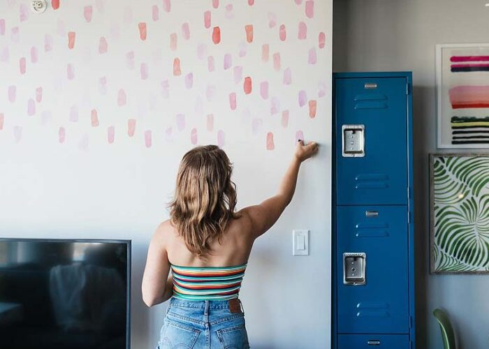 Blogger Bella Bucchiotti of xoxoBella.com shares about decorating her apartment with wall decals. She got the Urban Walls wall decals from Wayfair.