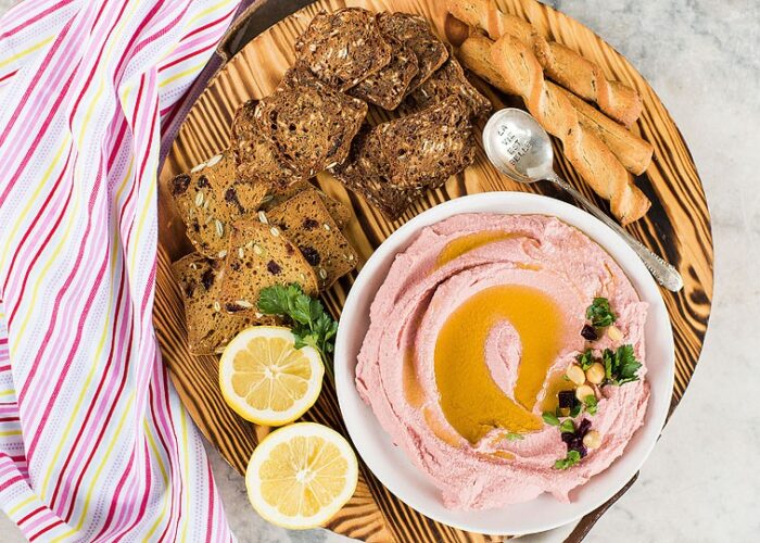 Blogger Bella Bucchiotti of xoxoBella.com shares a recipe for Millennial Pink Beet Hummus made with chickpeas and picked beet juice.