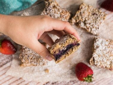 Blogger Bella Bucchiotti of xoxoBella.com shares a recipe for Vegan and Gluten-Free Strawberry Oat Bars.