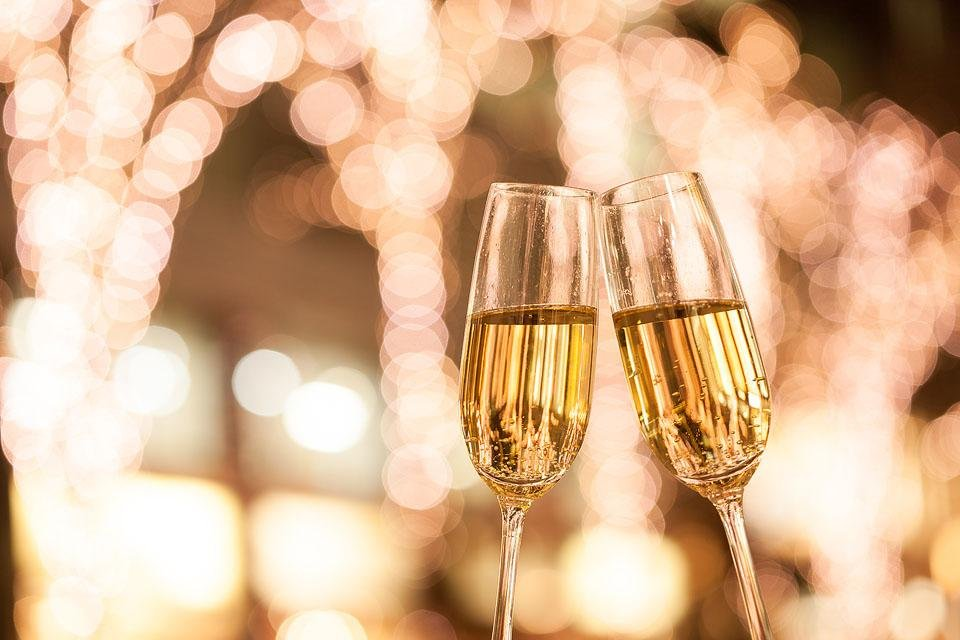 Lifestyle blogger, Bella Bucchiotti of xoxoBella shares a great list of champagne and wine captions. These are perfect for New Years Eve or for the wine lover.
