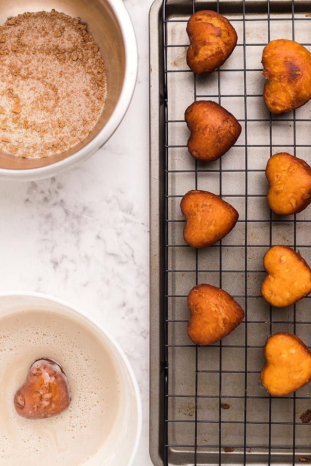 Food blogger, Bella Bucchiotti of xoxoBella shares a cinnamon roll hack recipe for heart shaped mini sugar doughnuts. This mini doughnut recipe makes a sweet Valentine's Day treat.