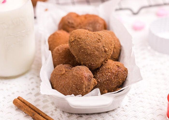 Food blogger, Bella Bucchiotti of xoxoBella shares a cinnamon roll hack recipe for heart shaped mini sugar doughnuts. This mini doughnut recipe makes a sweet Valentine's Day treat.