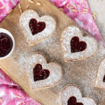 Food blogger, Bella Bucchiotti of xoxoBella shares a gluten free cookie recipe for Valentine's Day cookies. You will love these heart shaped gluten free Linzer cookies.
