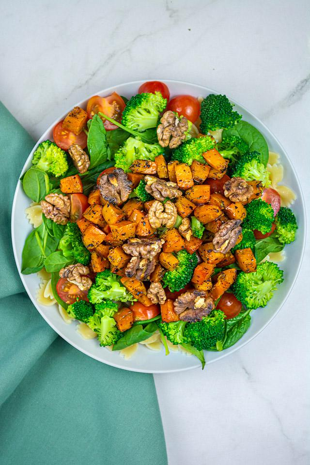 Food blogger, Bella Bucchiotti of xoxoBella, shares a recipe for broccoli pasta salad with roasted squash and walnuts. You will love this roasted squash salad.