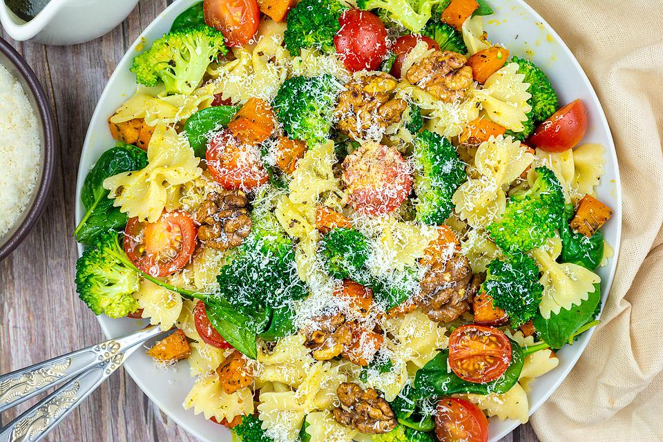 Food blogger, Bella Bucchiotti of xoxoBella, shares a recipe for broccoli pasta salad with roasted squash and walnuts. You will love this gluten free vegan pasta salad.