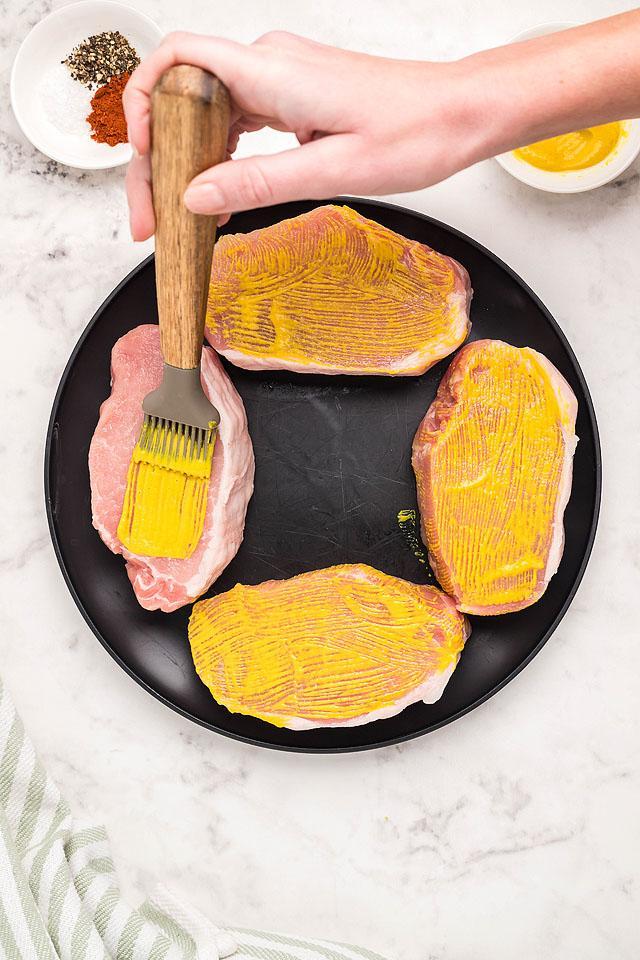 Food blogger, Bella Bucchiotti of xoxoBella shares a recipe for air fryer honey mustard pork chops. You will love these boneless pork chops.
