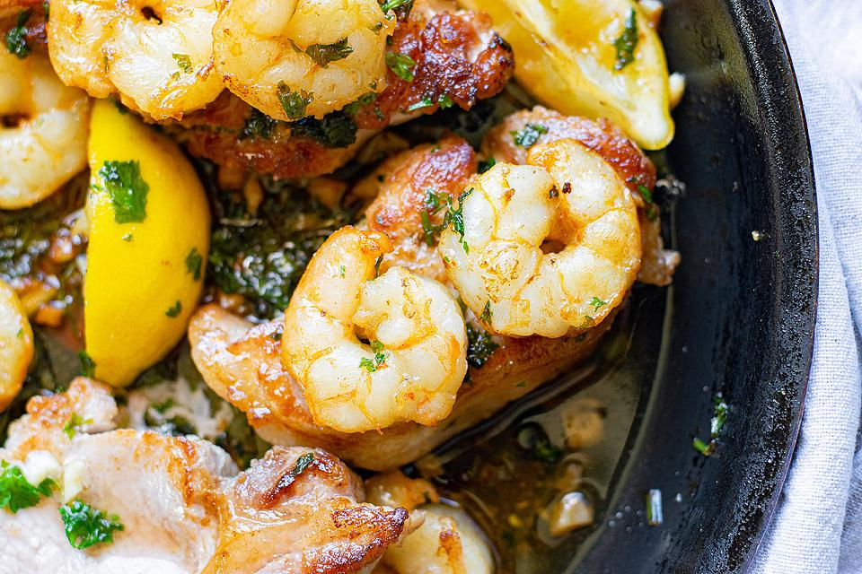 Food blogger, Bella Bucchiotti of xoxoBella, shares a recipe for pan seared pork chops! The butter herbed shrimp are tasty and this shrimp and pork chops recipe will be an instant favourite. This will be your go-to easy pork chops recipe.