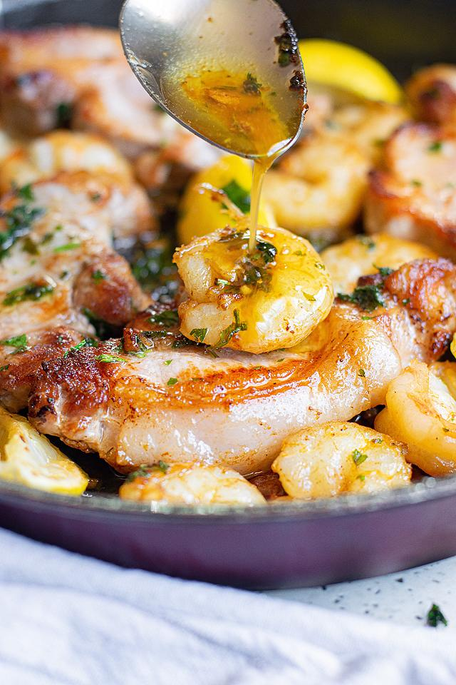 Food blogger, Bella Bucchiotti of xoxoBella, shares a recipe for pan seared pork chops! You will love this surf and turf pork and shrimp recipe.