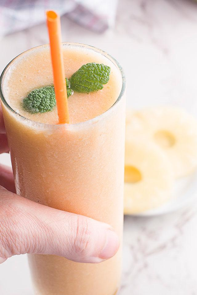 Food blogger, Bella Bucchiotti of xoxoBella, shares a recipe for a fresh pineapple peach smoothie. This is the best dairy free smoothie recipe.
