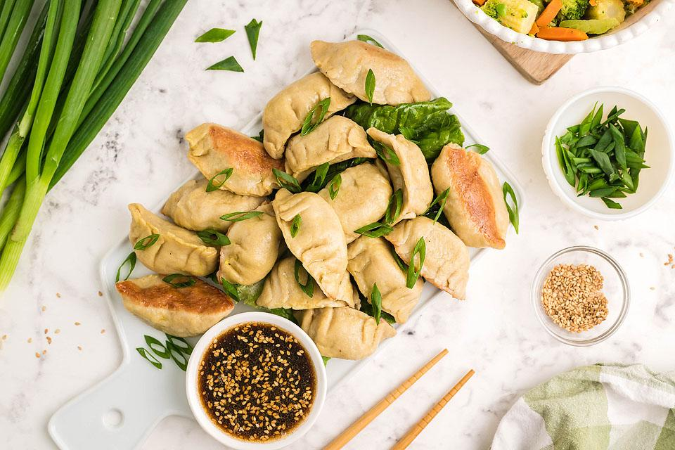 Food blogger, Bella Bucchiotti of xoxoBella, shares a recipe for gluten free potstickers. These bite-sized pork dumplings (aka Gluten free gyoza) come with a delicious sesame dipping sauce.
