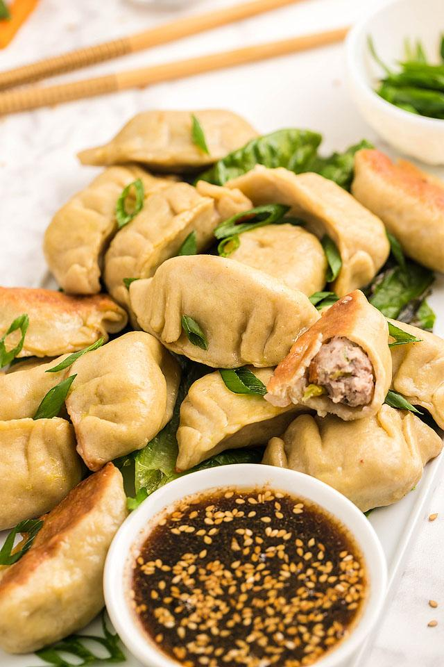 Food blogger, Bella Bucchiotti of xoxoBella, shares a recipe for gluten free potstickers. These bite-sized pork dumplings (aka Gluten free gyoza) come with a delicious sesame dipping sauce