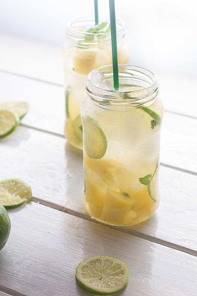 Food blogger, Bella Bucchiotti of xoxoBella, shares a  pineapple ginger mojito mocktail recipe. If you are looking for a pineapple mojito recipe, try this tropical mocktail!