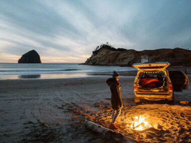 Travel blogger, Bella Bucchiotti of xoxoBella, shares a guide to Cape Kiwanda and Pacific City in Oregon. You can see Haystack Rock and some of the best drivable beaches in Oregon.