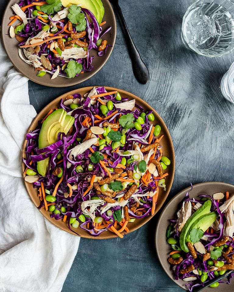 Food blogger, Bella Bucchiotti of xoxoBella, shares a recipe for sesame avocado Asian chicken salad with honey ginger dressing. You will love this cabbage salad recipe!