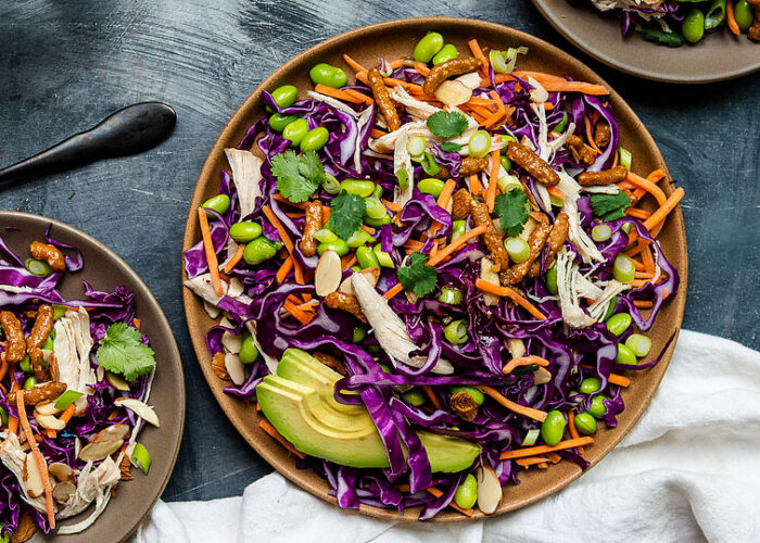 Food blogger, Bella Bucchiotti of xoxoBella, shares a recipe for sesame avocado Asian chicken salad with honey ginger dressing. You will love this cabbage chicken salad!