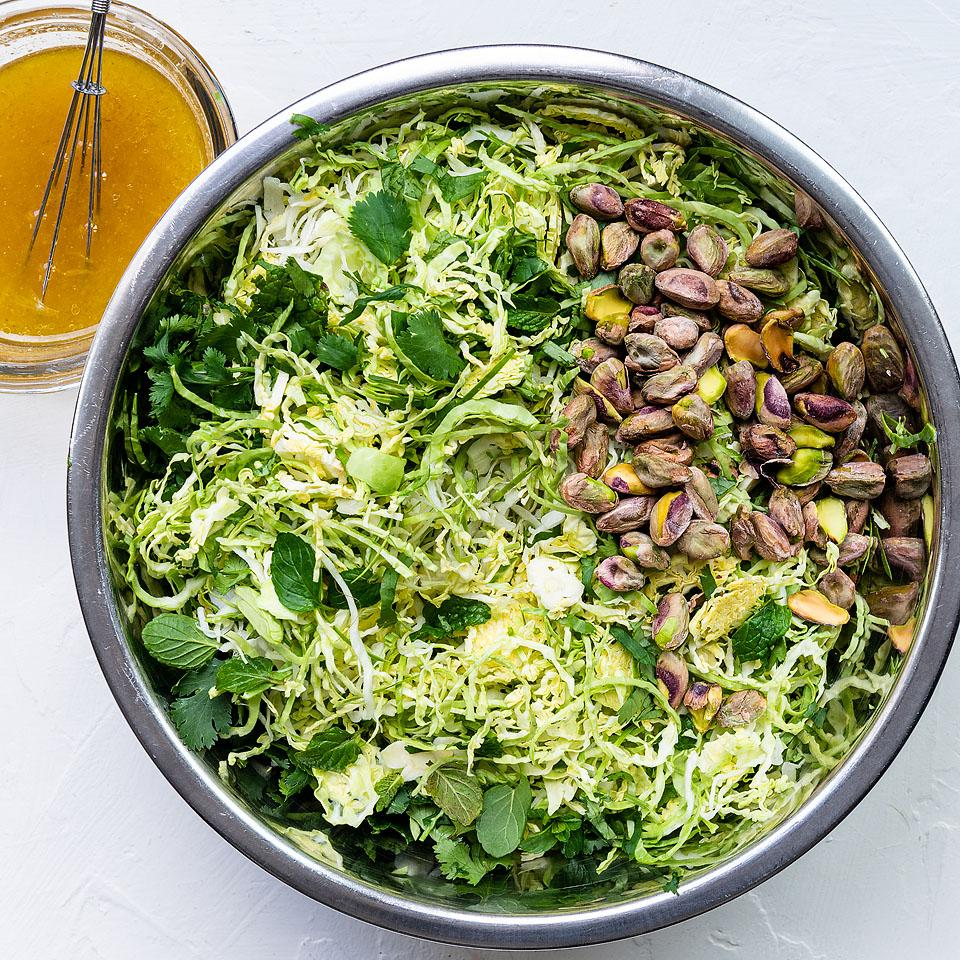 Food blogger, Bella Bucchiotti of xoxoBella, shares a Brussel sprout slaw with lemon apple cider vinaigrette. You will love this BBQ or summer salad recipe!