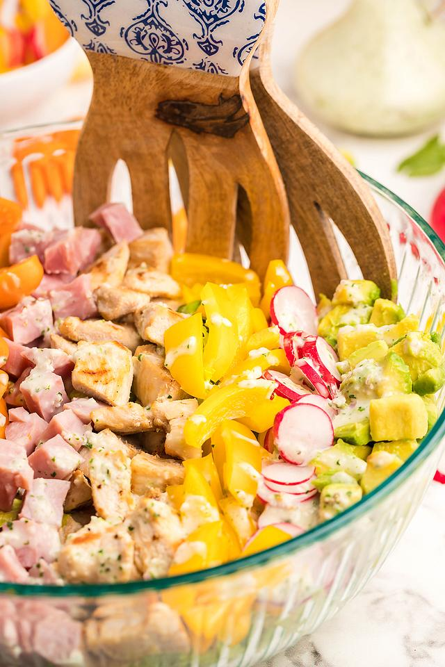 Food blogger, Bella Bucchiotti of xoxoBella, shares a recipe for Cobb salad with garlic cilantro dairy free ranch dressing. You will love this homemade ranch dressing.
