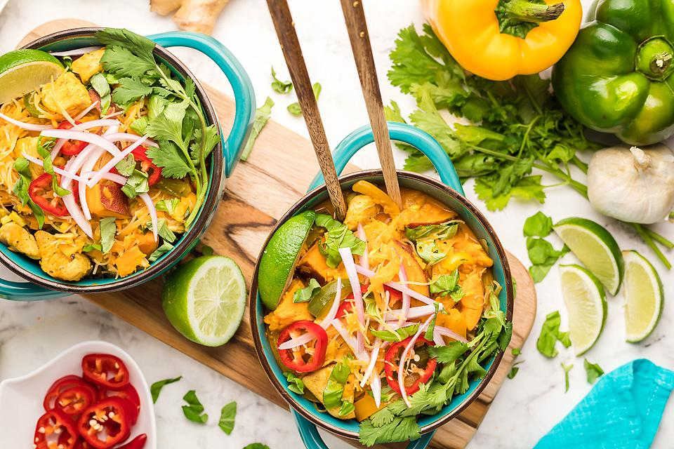 Food blogger, Bella Bucchiotti of xoxoBella, shares a red curry Thai coconut chicken soup with sweet potatoes and peppers. You will love this Thai chicken soup recipe!