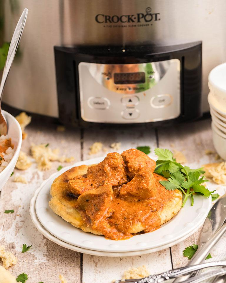 Food blogger, Bella Bucchiotti of xoxoBella, shares a recipe for slow cooker dairy free butter chicken with cauliflower rice. You will love this chicken curry recipe!