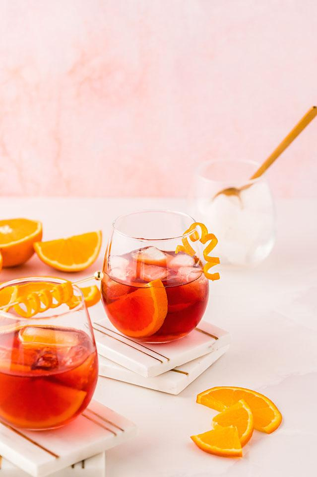 Food blogger, Bella Bucchiotti of xoxoBella, shares how to make the best negroni cocktail. You will love this cocktail with campari, gin and vermouth!