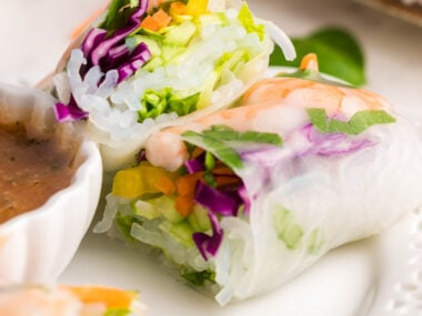 Food blogger, Bella Bucchiotti of xoxoBella, shares a recipe for a shrimp spring rolls with tasty spicy garlic sauce. You will love this tasty dipping sacue for spring rolls, too.