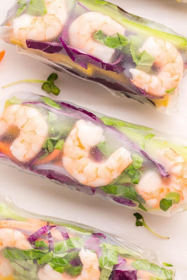 Food blogger, Bella Bucchiotti of xoxoBella, shares a recipe for a shrimp spring rolls with tasty spicy garlic sauce. You will love this shrimp spring roll recipe!