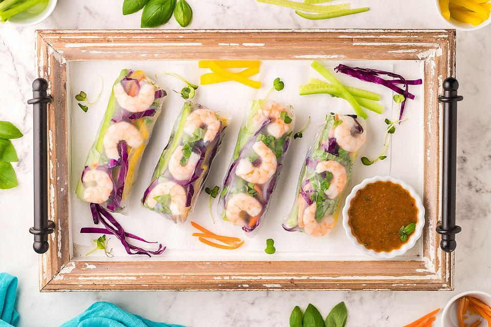 Food blogger, Bella Bucchiotti of xoxoBella, shares a recipe for a shrimp spring rolls with tasty spicy garlic sauce. You will love these fresh Vietnamese spring rolls.