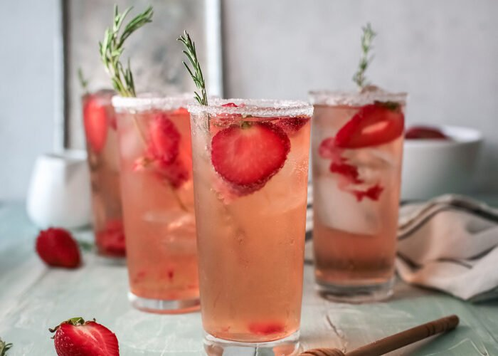 Food blogger, Bella Bucchiotti of xoxoBella, shares a strawberry paloma tequila cocktail with fresh grapefruit juice. You will love this easy paloma recipe.