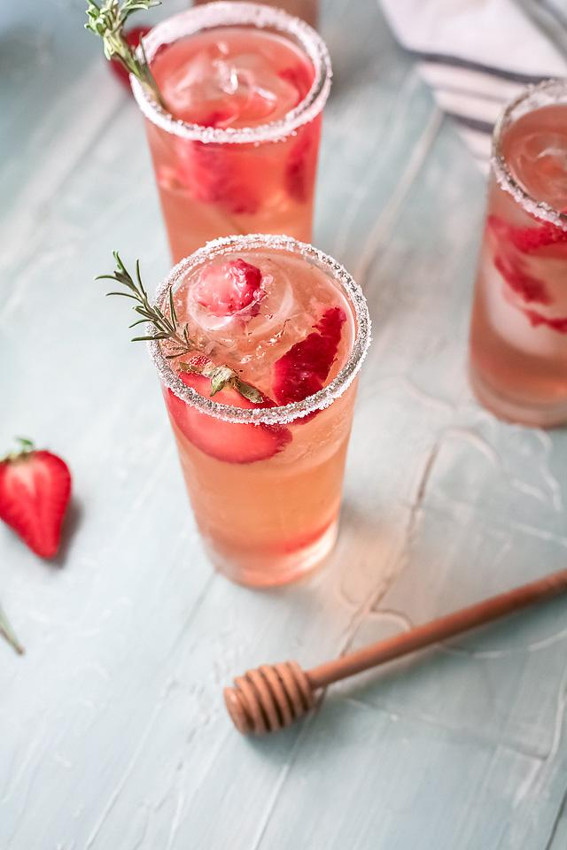 Food blogger, Bella Bucchiotti of xoxoBella, shares a strawberry paloma tequila cocktail with fresh grapefruit juice. You will love this cocktail with strawberries.