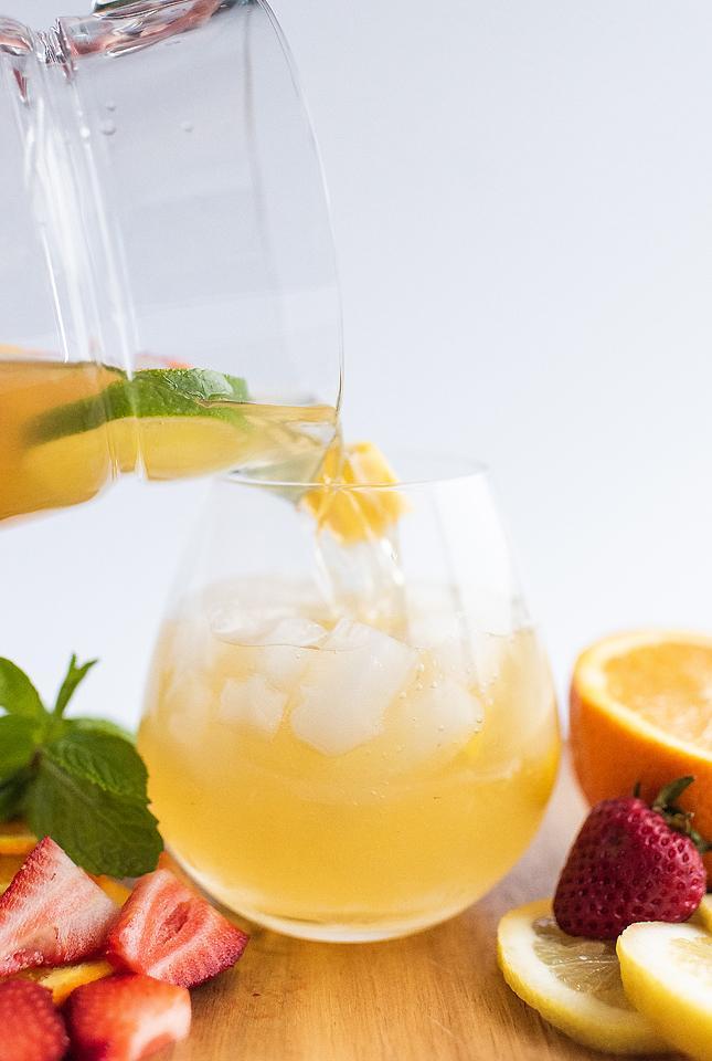 Food blogger, Bella Bucchiotti of xoxoBella, shares a mango citrus berry white sangria recipe. You will love this super easy sangria recipe!